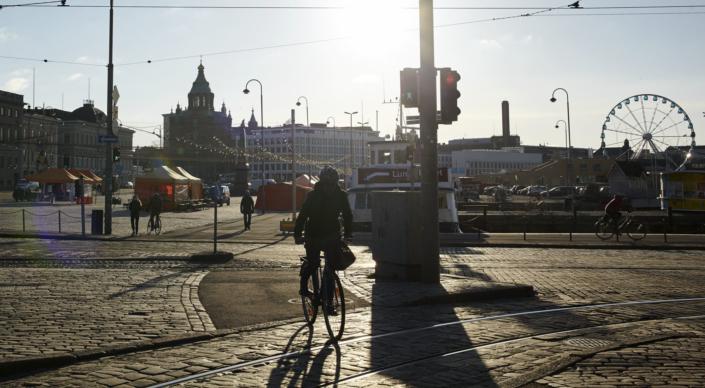 Biker crossing tram rails in Helsinki