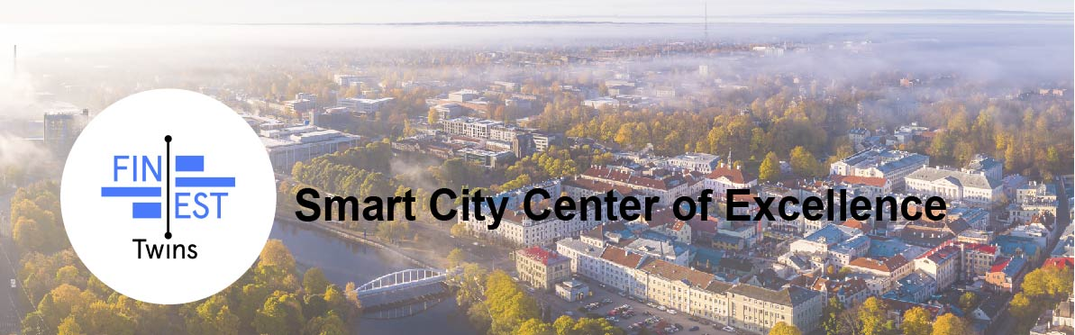 Aerial image of a city center and FinEstTwins logo