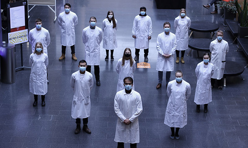 Finnadvance team in lab coats and face masks