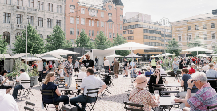People sitting at the Kasarmitori terrace in Helsinki